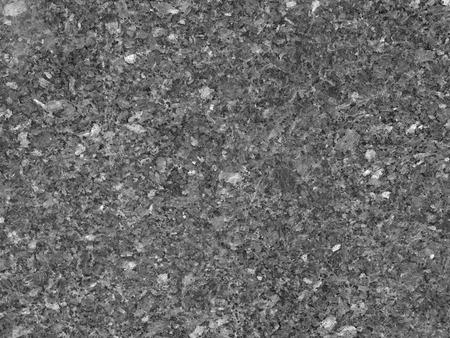 Close up of dark grey polished granite