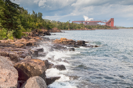 Taconite plant at Silver Bay in the background which sits along the shore of Lake Superior