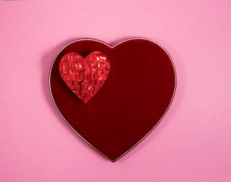 Glittery heart on a velvet heart on pink
