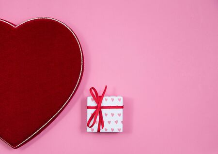 Velvet box of valentines day chocolates and a wrapped gift