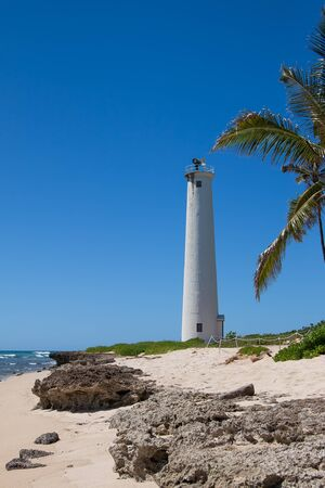 Barbers point lighthouse on Oahu on a bright sunny day with a blue sky