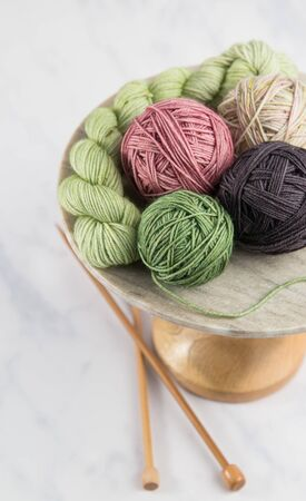 Balls of yarn for a project on a stand with knitting needles and a neutral background Banque d'images