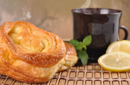Still Life with sweet buns, lemon and coffee photo