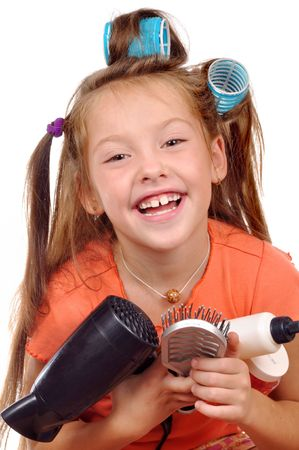 Girl with a comb in hair curlers on a white background photo