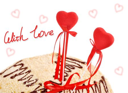 two red hearts in a target of cake on a white background photo