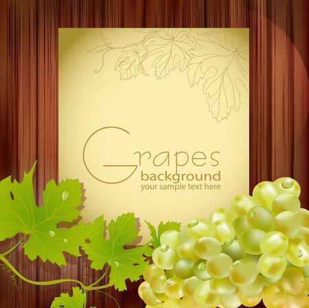 grape crop: fresh grapes with drops of dew and leaves on wooden background with space for text