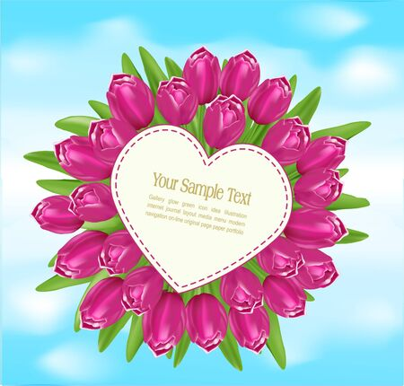 tulips in green grass: bouquet of tulips with a greeting card in the form of heart on blue sky background