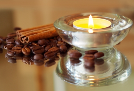 anisetree: romantic background with candles, coffee beans and cinnamon