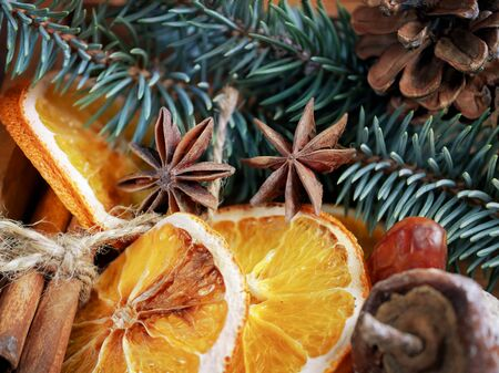 Christmas holiday composition : Beautiful close-up branches of spruce , of dry Oranges, Cinnamon sticks and star Anise, dried fruits, fir cones in  a wooden box. Zdjęcie Seryjne