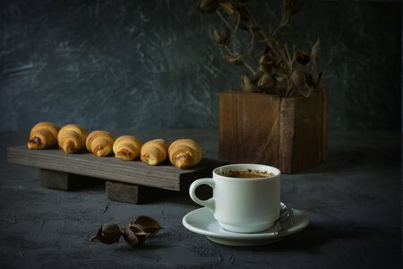 old-style still life with croissants and a cup of coffee  Zdjęcie Seryjne