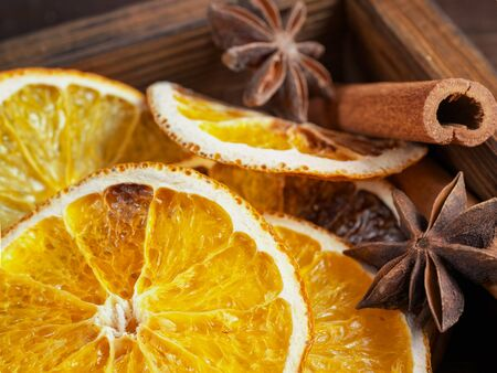 Holiday background. Christmas composition : Beautiful close-up  of dry Oranges, Cinnamon sticks and star Anis.