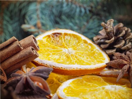 Christmas holiday composition : Beautiful close-up branches of spruce , of dry Oranges, Cinnamon sticks and star Anise, dried fruits, fir cones