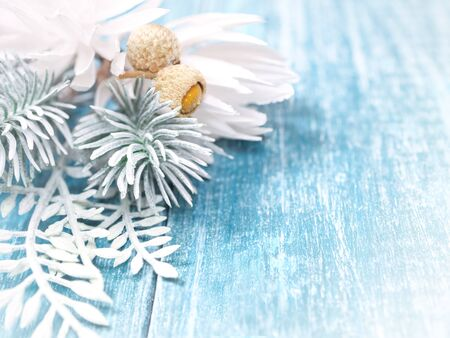 Christmas, New Year background. White spruce branches, cones, on a blue wooden background.  Close up. Place for text.