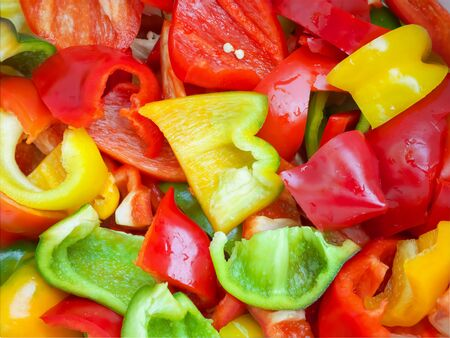 Food concept. Background for design. Multi-colored chopped peppers.