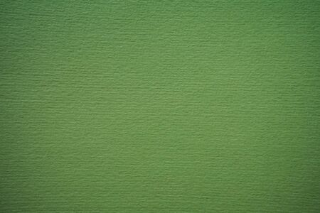 Textured green cardboard. Close-up. Craft Paper Texture. Template for design Zdjęcie Seryjne