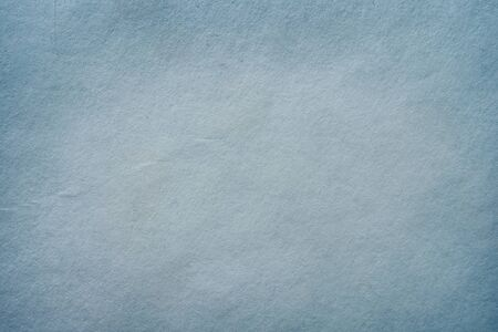 Grunge blue-gray textured background of cardboard, paper. Close-up.