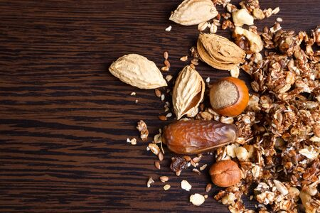 Granola with nuts and grains on a wooden background. Top view. Zdjęcie Seryjne