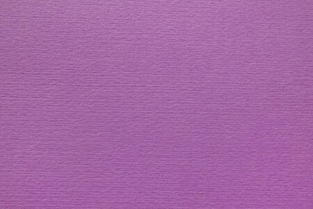 Textured lilac cardboard. Close-up. Craft Paper Texture.