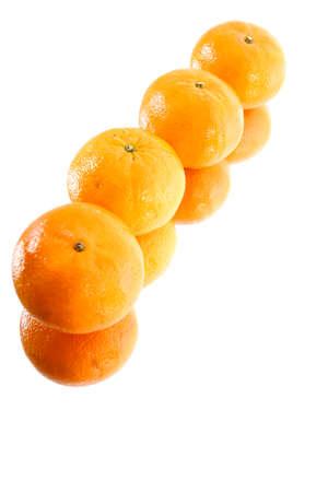 orange peel clove: quattro mandarino su superficie a specchio Archivio Fotografico
