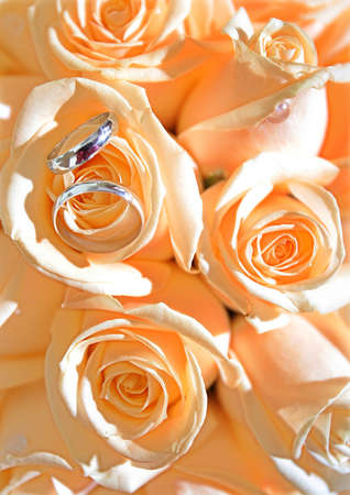 marriageable: Wedding rings on bridal bouquet of yellow roses