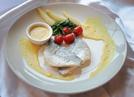 dolphinfish dish with sauce photo