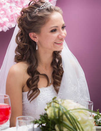 young bride in restaurant sit by banquet table photo