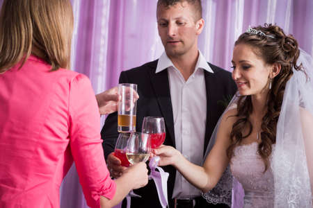 Handsome groom and young beautiful bride on banquet  in restaurant photo
