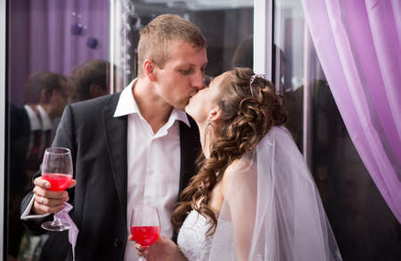 Handsome groom kiss young beautiful bride on banquet  in restaurant photo