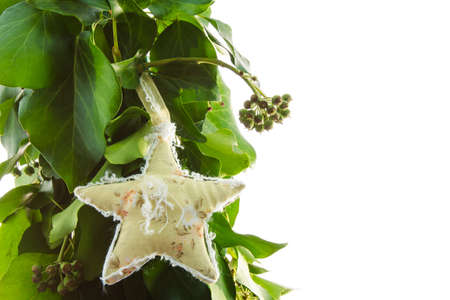 star handmade toy on design green New Year tree isolated on white background photo