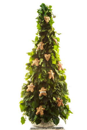 exclusive handmade toys on design green New Year tree isolated on white background photo