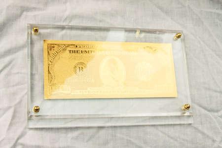 handmade golden dollar symbol lay on white background photo