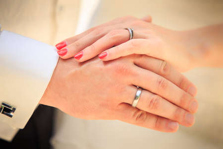 ring wedding: bride and groom hands with golden rings clouseup