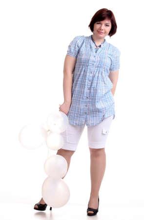 chemise: european brunette short-haired girl in blue chemise with white balloons