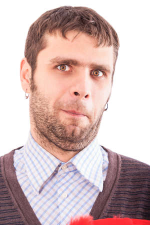 ear rings: handsome bearded light brown-haired european guy with ear rings makes faces Stock Photo