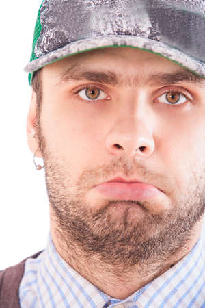 ear ring: closeup portrait of handsome bearded european guy in base-ball cap with astonished expression on face and in ear-rings