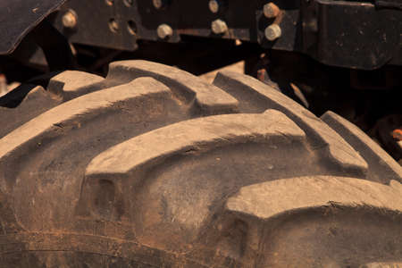 treads: closeup grey tractor wheel tire