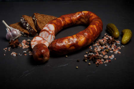 smoked sausage with garlic, pickled cucumbers, and rye bread