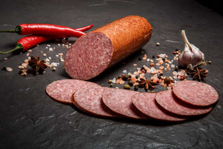 small chunk of smoked cervelat salami sausage with garlic and chili