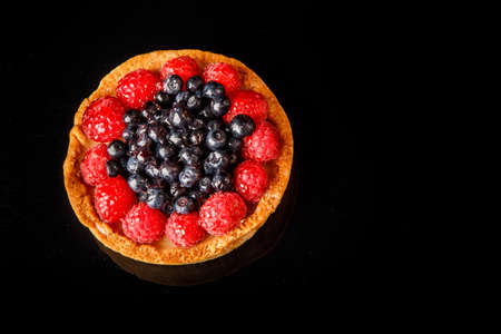 top view closeup shortbread mini tart with custard and berries