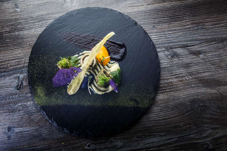 top view of exclusively decorated fish rolls stuffed with herbs served with delicious garnish on wooden table background Stock fotó