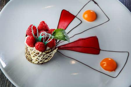 closeup finely decorated chocolate cream raspberry dessert 写真素材