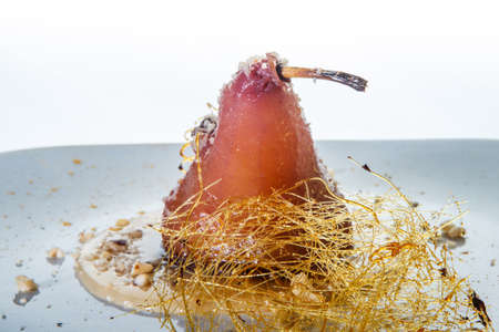 closeup homemade whole pear finely decorated with caramel 写真素材