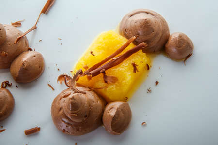 macro view on finely decorated fruit and chocolate mousse dessert