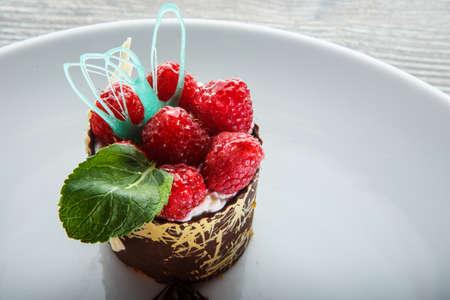 closeup elegantly decorated chocolate cream raspberry dessert