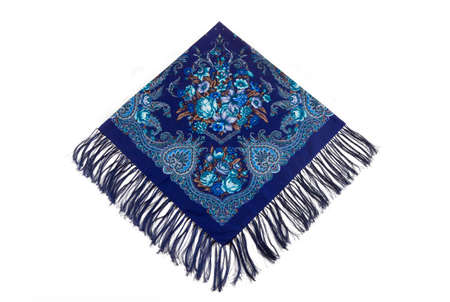top view flat lay on blue cotton scarf with fringe, paisley and floral pattern with large roses ornament served on white background