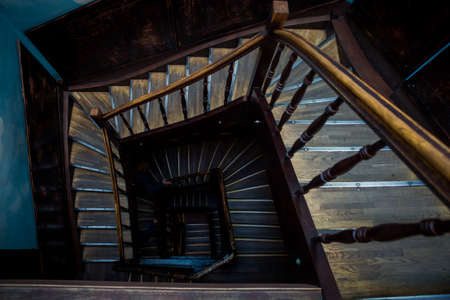 top view closeup view of empty wooden staircase in old house in historical quarter of Lviv city, Ukraine 写真素材