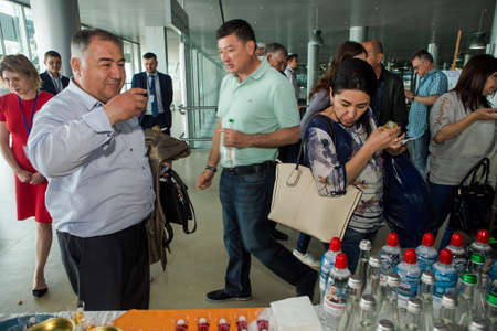 LVIV, UKRAINE - MAY 24, 2018: many passengers take part in free alcohol degustation in Lviv international airport on May 24 in Lviv