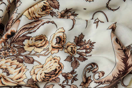 top view closeup crumpled milk soft cotton female scarf with brown floral ornament with large beige flowers
