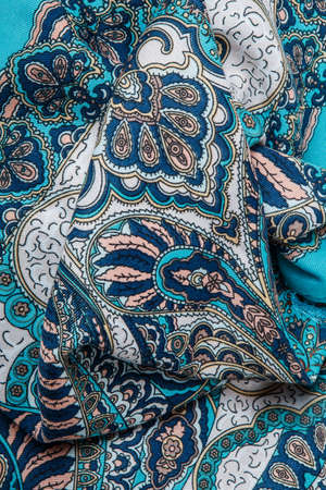 top view closeup crumpled blue cotton scarf with bright oriental ornament with paisley print 写真素材