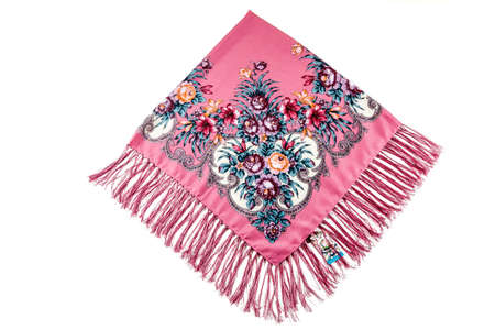 top view on folded pink cotton scarf with fringe and colorful floral ornament with violet roses and red lilies flat lay isolated on white background 写真素材